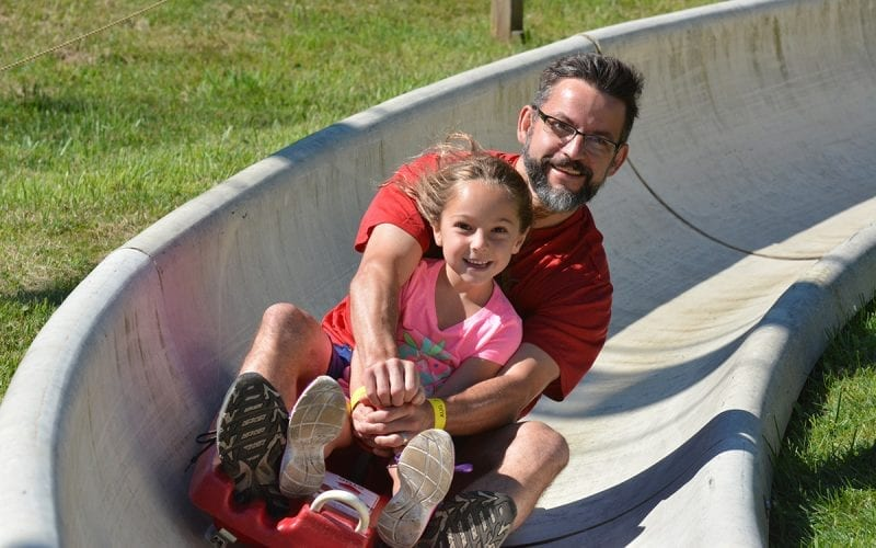 Adult and Child on the Alpine Slide