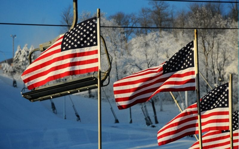 American Flags and snow covered slopes