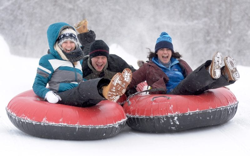 Group of adults Snow Tubing