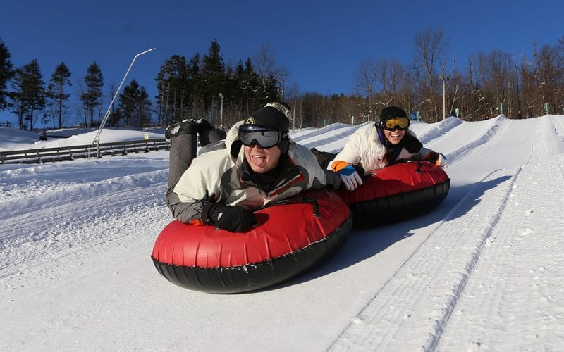 Two adults Snow Tubing