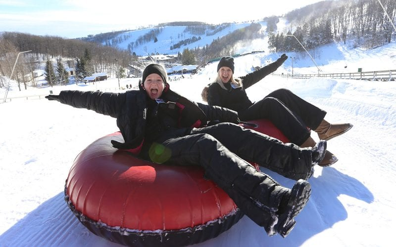 Child and adult Snow Tubing