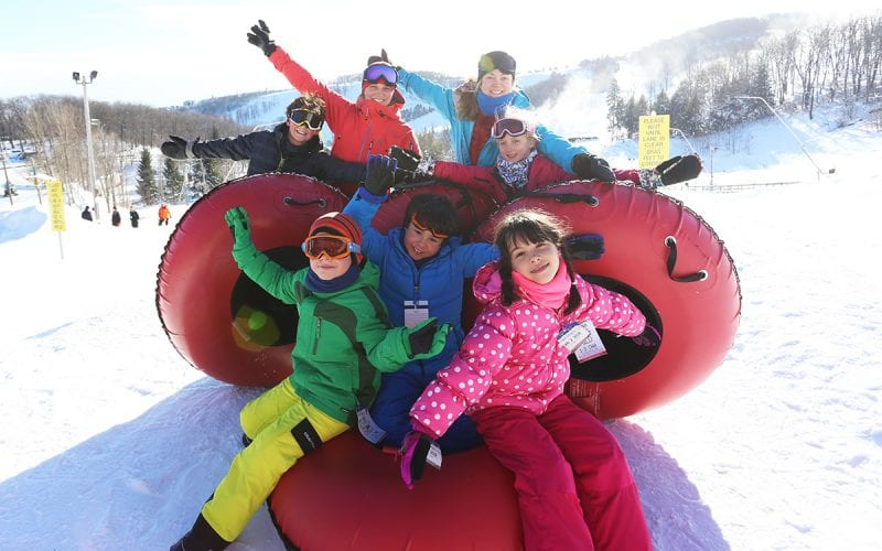 Group of children Snow Tubing