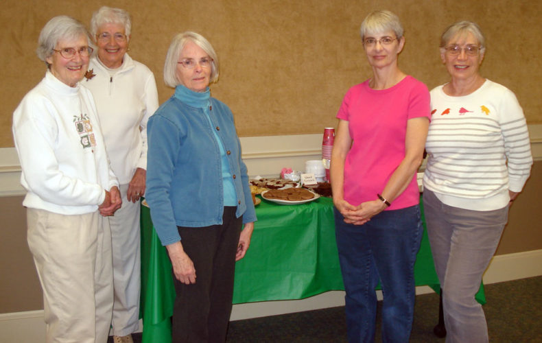 LIBRARY LUNCHEON SERIES VOLUNTEERS — From left are Joy Harvey (chair), Anne Boutilier, Shirley Morgan and Siobhan Crary, who make up the Saranac Lake Free Library Hospitality Committee, shown with Library Luncheon Series Coordinator Rosalie Fontana, right. The noon programs are offered free of charge every other Thursday, with desserts and beverages provided by this committee and other bakers. (Photo provided — Pat Wiley)