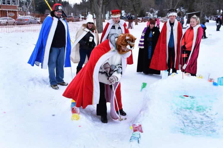 SaranacLake Winter Carnival's 2017 royalty plays Arctic Golf Sunday in Prescott Park.  (Photo provided)