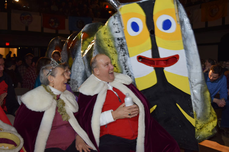 The Rotary Dancers, dressed as a caterpillar, enter the Harrietstown Town Hall auditorium Friday night, surprising Saranac Lake Winter Carnival King John Wamsganz and Queen Anita Meserole, during the final performance of the annual Rotary Club Variety Show. (Enterprise photo —Chris Knight)