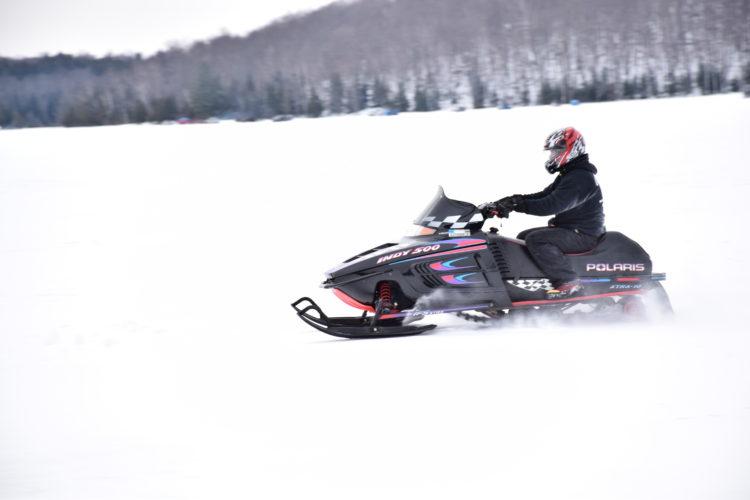 A smowmobile rides across Lake Colby.  (Enterprise file photo — Lou Reuter)