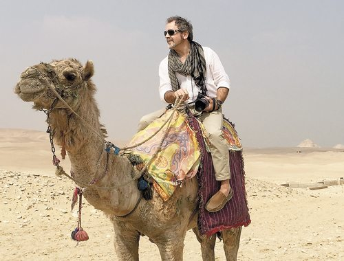 Loon Lake native Dick Roberts rides a camel in Giza, Egypt last month while gathering footage for a documentary series he's working on. (Photo provided)