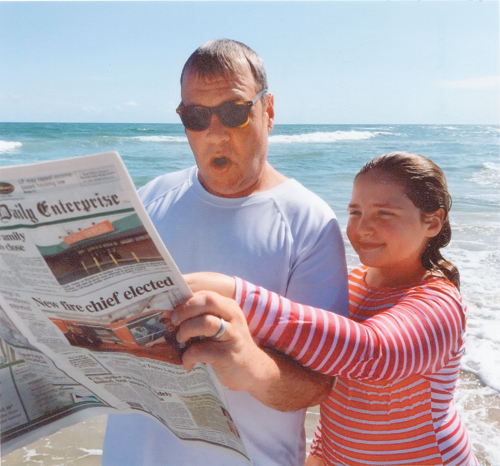 Patrick Duffy and Grace Duffy stay up to date with the events back home while in Ocracoke, North Carolina in April.