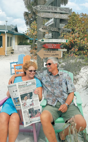 Ed and Linda Grant stay connected to home during their visit to South Beach Bar and Grill in Boca Grande, Florida.