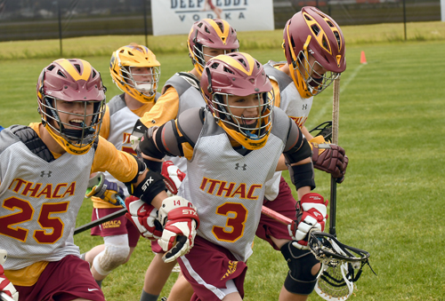 Players from Ithaca's modified team begin their celebration after the final whistle blows during Wednesday's 2021-22 championship game in the Lake Placid Youth Classic lacrosse tournament. (Enterprise photo — Lou Reuter)