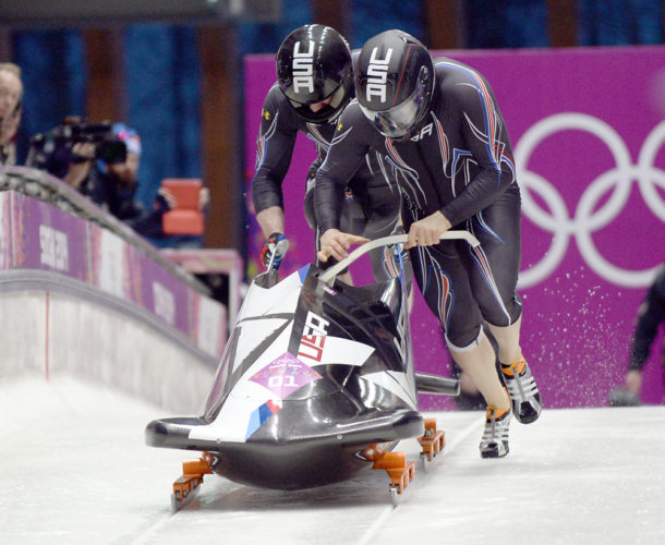 USA 1 driver Steven Holcomb and his push athlete Steve Langton start a run during the two-man bobsled competition at the 2014 Sochi Winter Olympics. (Enterprise file photo — Lou Reuter)
