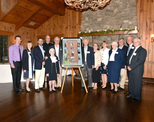 """Mercy Care Board of Directors presented Volunteers with the """"Doors of Mercy,"""" a photo collage project developed by elders and volunteers depicting elders opening their doors to their Mercy Care Friends.  (Photo provided)"""