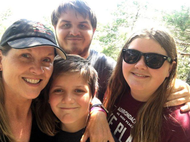 From left, Denise Sheaks Burke and her children Garrett (behind), Austin and Taylor pose on Baker Mountain in Saranac Lake. (Photo provided by Denise Sheaks Burke)