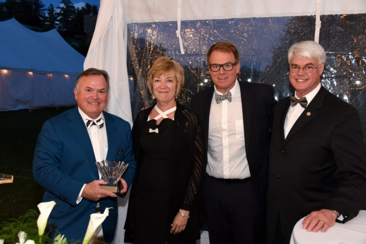 W. Scott McGraw, far left, receives the Dr. Edward L. Trudeau Award at the Black and White Bow Tie Gala, hosted by the Adirondack Health Foundation. Pictured from left are McGraw; Sylvia Getman, president & CEO of Adirondack Health; Kevin Brady Adirondack Health Foundation board of trustees chair; and Philip Glotzbach, president of Skidmore College. (Photo provided — Adirondack Health)
