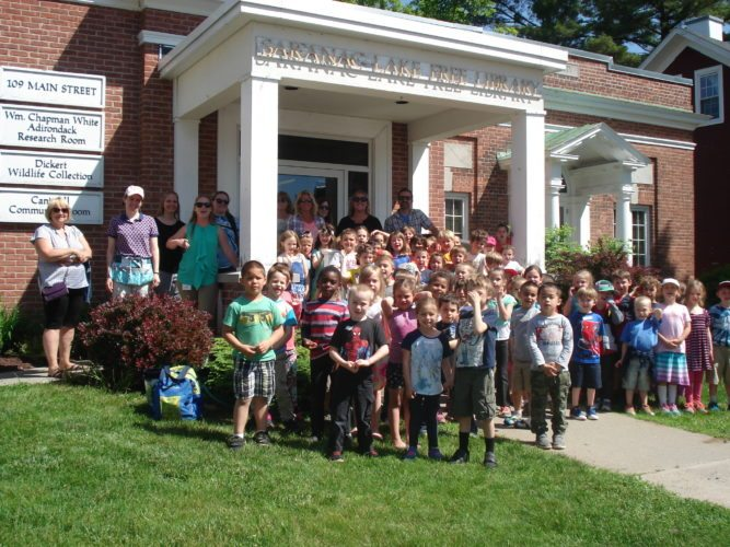 Around 55 kindergarten students from Petrova Elementary School walked to the Saranac Lake Free Library on Thursday, June 16. They listened to a story in the Elinor B. Preis Children's Room, toured the Dickert Wildlife Room and received their own library card. Teachers are Katie Laba, Kyle Mochol, Beth Guglielmi, Jamie Rohe and Krista Weakley.  Teacher assistants and aids included Tammy Wright, Jen Everritt, Laurie Woodruff, Misty Sinclair and Debi Yando. (Photo provided)