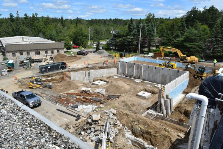 The foundation for Adirondack Medical Center's new surgical services addition to its Saranac Lake hospital is about 50 percent complete, as seen here on Friday. (Enterprise photo — Chris Knight)