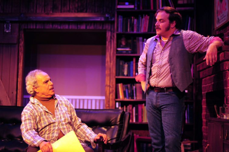Sidney Bruhl, left and played by Jordan Hornstein, talks to Clifford Anderson, right and played by Tyler Nye, in Thursday's dress rehearsal of Deathtrap at the Pendragon Theatre. (Enterprise photo — Kevin Shea)
