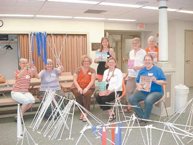 """SUMMER READING PROGRAM LEADERS AND ASSISTANTS —""""Build a Better World"""" was the theme for the 2017 Children's Reading Program. Program leaders are shown behind paper constructions created by the children. Standing from left, Anna Ellithorpe, Linda Beairsto, Hilde Hammond. Seated from left, Marcia Gilbert, Karen Smith, Linda Grant, Linda Jackson and Peggy Orman, youth programs coordinator. Kerri Langer also helped with the program.   (Photo provided —Pat Wiley)"""