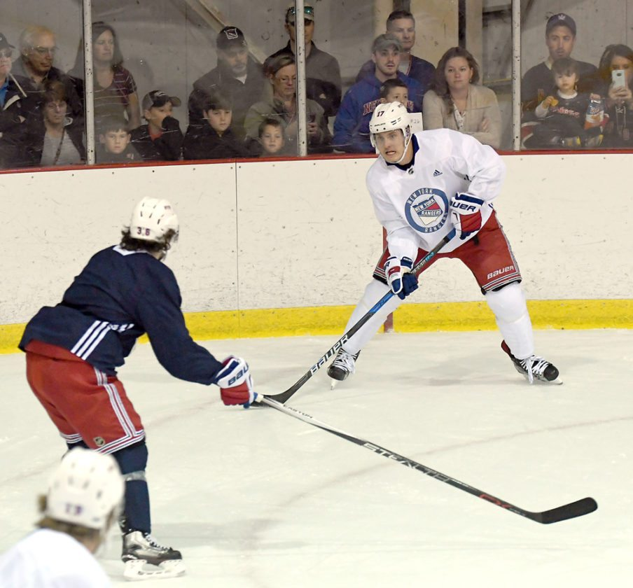 Jesper Fast controls the puck while Mats Zuccarello defends during the New  York Rangers practice Monday at the Olympic Center s USA Rink. d95f9f4a7
