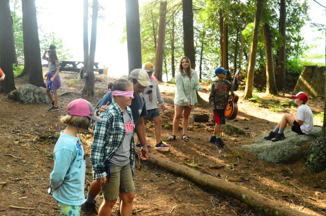 """a83086e611c Camp Director Katrina Dearden is led by campers, blindfolded, around Eagle  Island while playing """"Hug a Tree."""" (Enterprise photo — Aaron Cerbone)"""