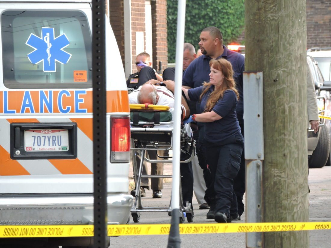 WOUNDED —  Ambulance Service Inc. employees prepared to put Jefferson County Common Pleas Judge Joseph Bruzzese Jr. into an ambulance Monday morning after the judge was shot by Nathaniel Richmond on Court Street. Law enforcement officials said Richmond waited at the west side of the Jefferson County courthouse to ambush the judge, who exchanged gunfire with Richmond. A court probation officer saw the incident and also shot Richmond, who died at the scene.  -- Dave Gossett