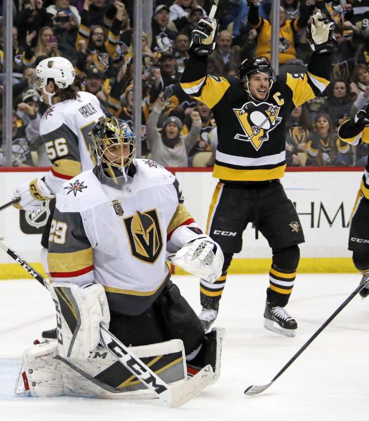 Pittsburgh Penguins  Sidney Crosby (87) celebrates assisting on a goal by  Ian Cole as Vegas Golden Knights goaltender Marc-Andre Fleury (29) collects  ... ef399a89a