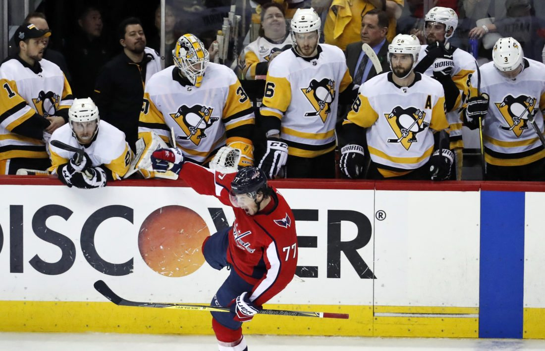 f4032639f6d Washington Capitals right wing T.J. Oshie (77) celebrates his empty-net  goal in front of the Pittsburgh Penguins bench during the third period of Game  5 in ...