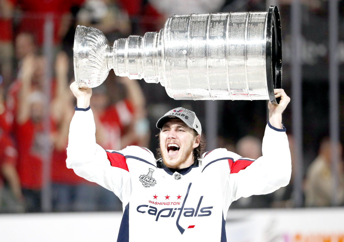 f3a4ccf5839 Washington Capitals right wing T.J. Oshie hoists the Stanley Cup after the  Capitals defeated the Golden Knights 4-3 in Game 5 of the NHL hockey Stanley  Cup ...