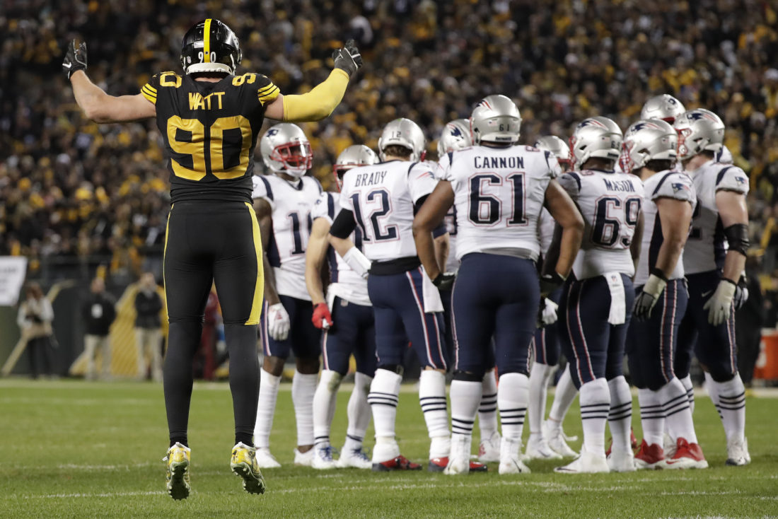 03d335a5e19 Pittsburgh Steelers outside linebacker T.J. Watt (90) calls the crowd to  action as New England Patriots quarterback Tom Brady (12) huddles his team  during ...