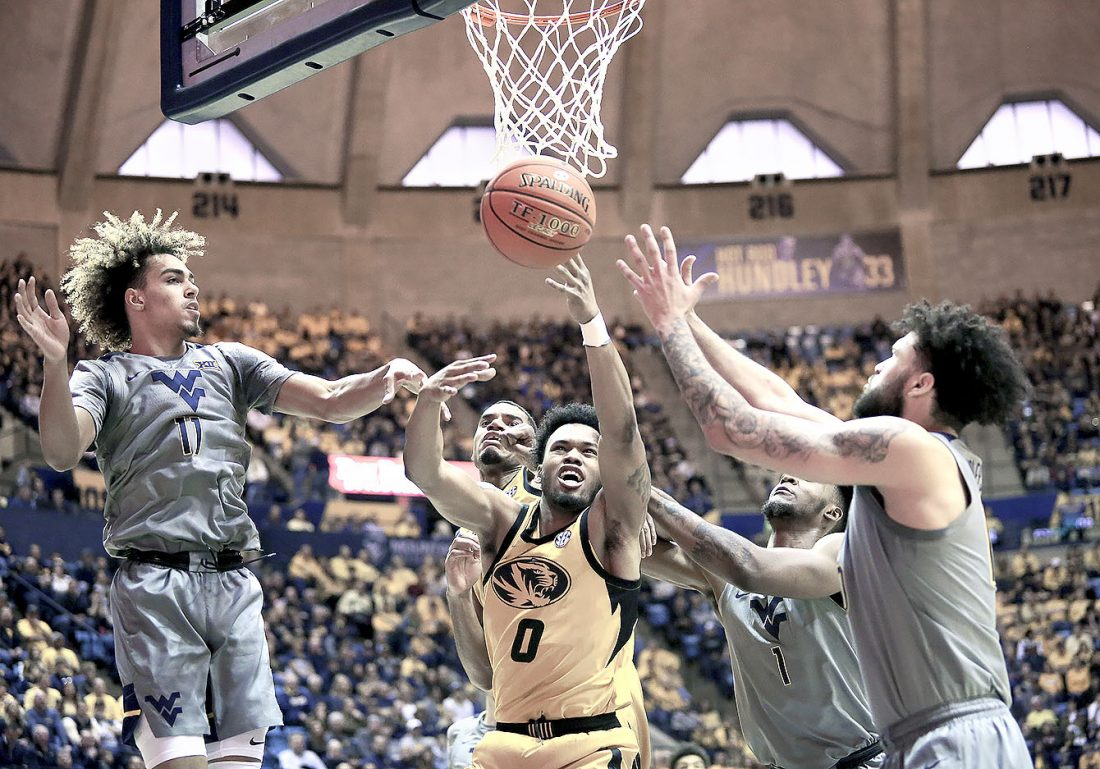 No. 14 WVU beats Missouri in Big 12/SEC Challenge