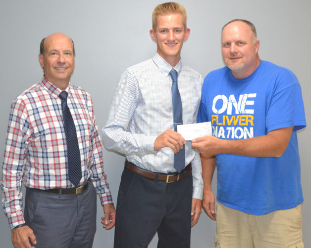 The Dickinson County Area Paisano Club recently awarded two area high school graduates with $500 scholarships. Recipients were Matt Swanson and Dominic Occhietti. Here, Swanson receives his check from Nick Simone, left, and Mark Pugh, right, both of the Paisano Club. Any resident of the Dickinson County area who is of Italian descent or married to someone of Italian descent is eligible for membership in the Paisano Club. Annual membership is $10. Anyone interested in joining the club can call Simone at 906-774-2066 for more information. The Paisano Club wishes to extend its congratulations and best wishes to for a successful future to all area graduates, Simone said.