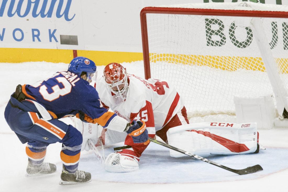 0057e995e20 New York Islanders center Mathew Barzal (13) scores the winning goal past  Detroit Red Wings goaltender Jonathan Bernier (45) during a shootout on  Saturday, ...