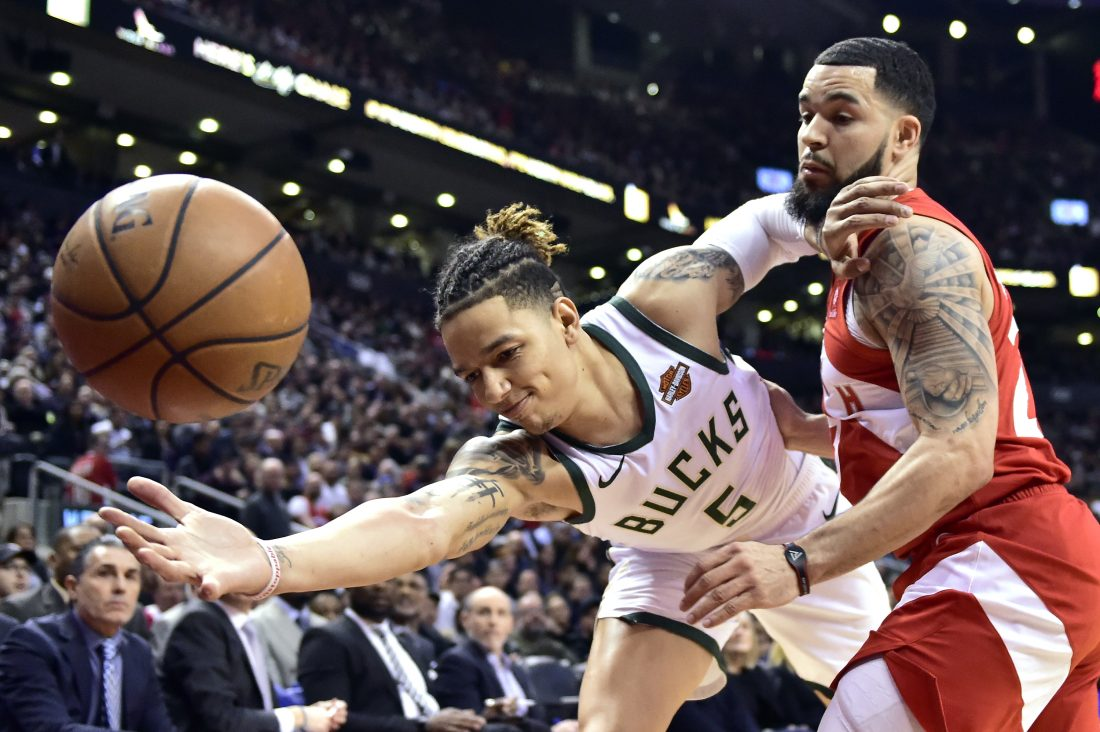 c577a4b7f8d Toronto Raptors guard Fred VanVleet, right, forces a turnover against Milwaukee  Bucks forward D.J. Wilson (5) Thursday Jan. 31, 2019 in Toronto.