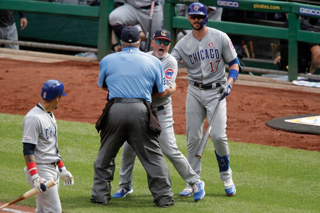 Maddon restrained by umpire, players during heated exchange with Pirates