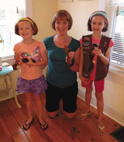 Brynn Thomarie, Shannon Thomarie and Leanora Fitzgerald pose with their donations and their new 'dos. (Photo submitted)
