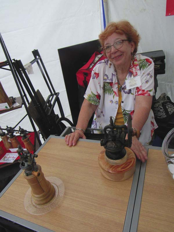 Theresa Olsen displays pepper and coffee grinders made by her and husband, George, of GTO Woodturning of Richmondville. (The Leader-Herald/Eric Retzlaff)