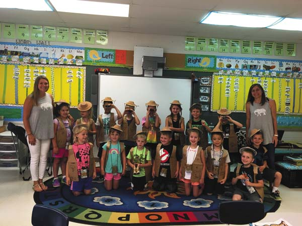 Broadalbin-Perth first-graders pose with teachers Ashley Meyer, left, and Melissa Ossenfort, right. The students are wearing the safari hats, vests and binoculars they made while learning about elephants. (Photo submitted)