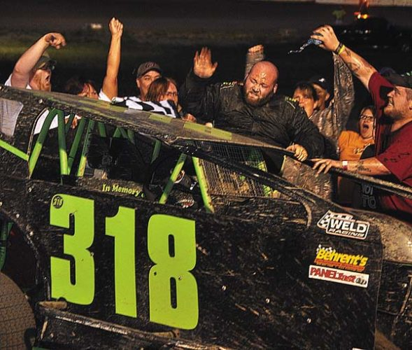 The Leader-Herald/James A. Ellis The family and friends of Ed Richer celebrate in Victory Lane as Dave Richer climbs from his car after winning the Limited Sportsman main event one week after his father Ed died from a heart attack.
