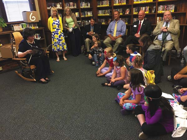 New York state Department of Education Commissioner MaryEllen Elia reads to children at the Amsterdam Free Public Library Monday.  (The Leader-Herald/Jason Subik)