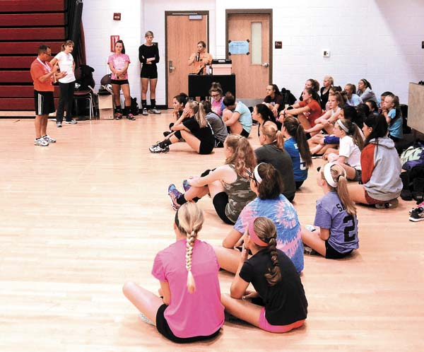 Gloversville varsity volleyball coach Duane Hicks, left, speaks with campers during the Gloversville volleyball camp on Monday at Gloversville High School. (The Leader-Herald/Bill Trojan)