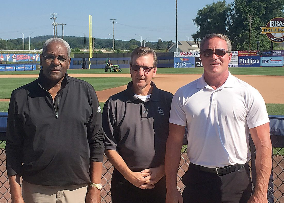 Sentinel photo by BEN BRIGANDI  Bob Gibson, left, Little League CEO Steve Keener, center, and Andy Van Slyke pose for a picture at Bowman Field in Williamsport, Monday.