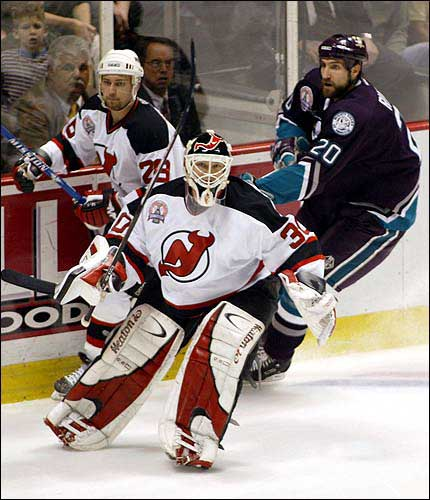 5c915edb9ad New Jersey goalie Martin Brodeur clears the puck from the corner ahead of  Anaheim's Steve Rucchin and Grant Marshall. The Devils beat the Mighty Ducks,  3-0, ...