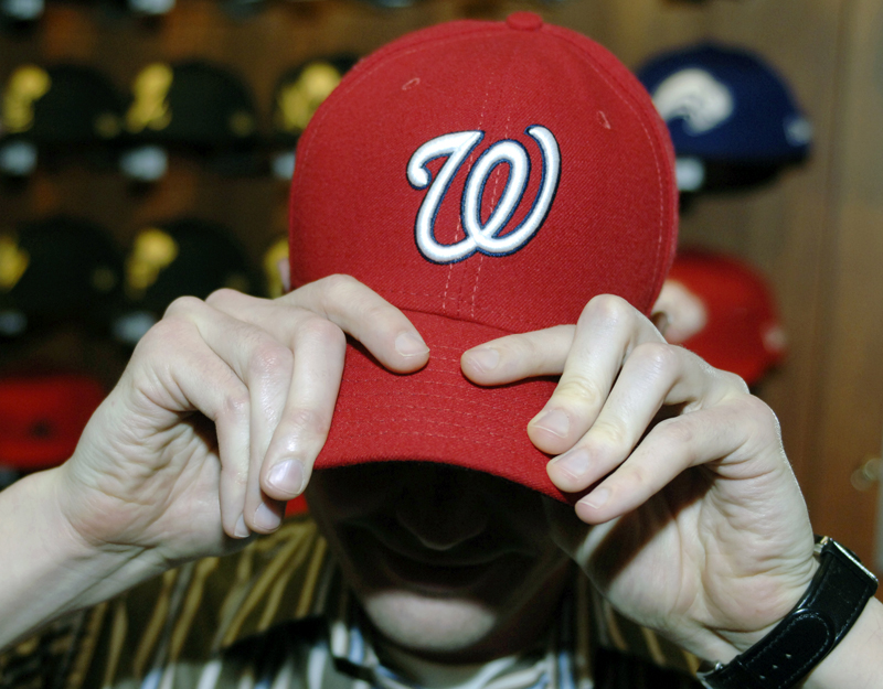 ae5abffe0e4873 A New Era Cap Co. employee, Mike Wozniak, models a 59 FIFTY Authentic  Collection On Field Cap with the Washington Nationals logo at the company's  ...