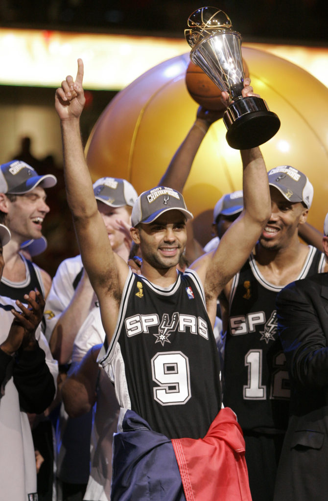 c37abecbe10f San Antonio s tony parker hoists the NBA Finals MVP trophy. The Spurs swept  the series against the Cavaliers.