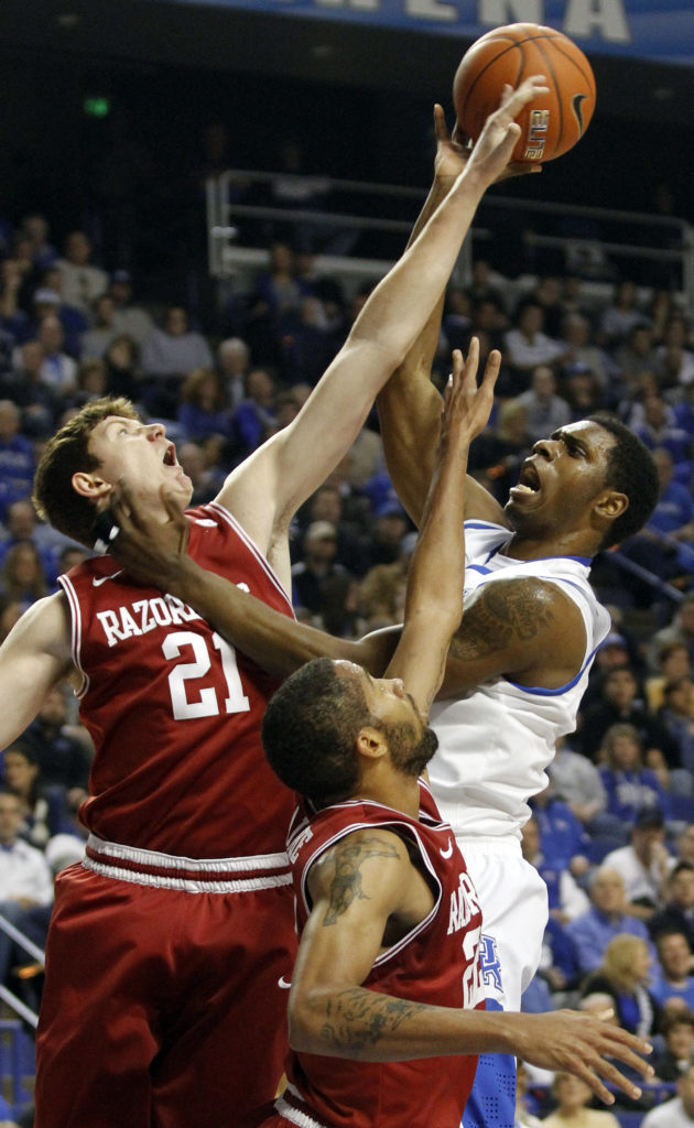 size 40 197fa 62630 ... shot under pressure from Arkansas  Hunter Mickelson (21) and Marvell  Waithe during the first half of an NCAA college basketball game in Lexington,  Ky., ...