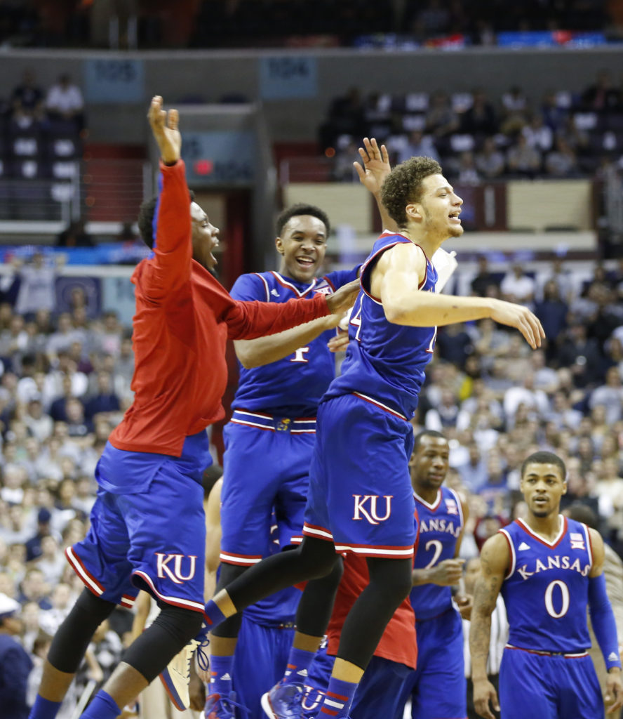 bb662508971 Kansas guard Brannen Greene, right, celebrates with teammates Devonte  Graham, center, and Jamari Traylor during a timeout after a three by Greene  in the ...
