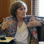 In this Wednesday, Feb. 13, 2019 photo, Kansas state Sen. Barbara Bollier, D-Mission Hills, makes a point during a meeting of Democratic senators at the Statehouse in Topeka, Kansas. (AP Photo/John Hanna)