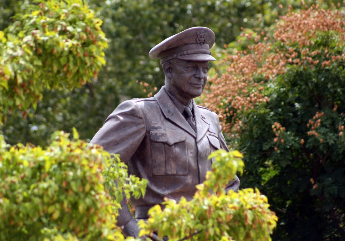 This Aug. 4, 2012 file photo shows a large bronze statue of Dwight D. Eisenhower that stands over the grounds of his presidential library, museum and boyhood home in Abilene.