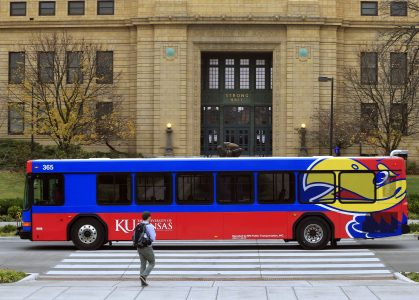 A bus passes in front of Strong Hall on Nov. 16, 2015, on the University of Kansas campus. (AP Photo/Orlin Wagner)