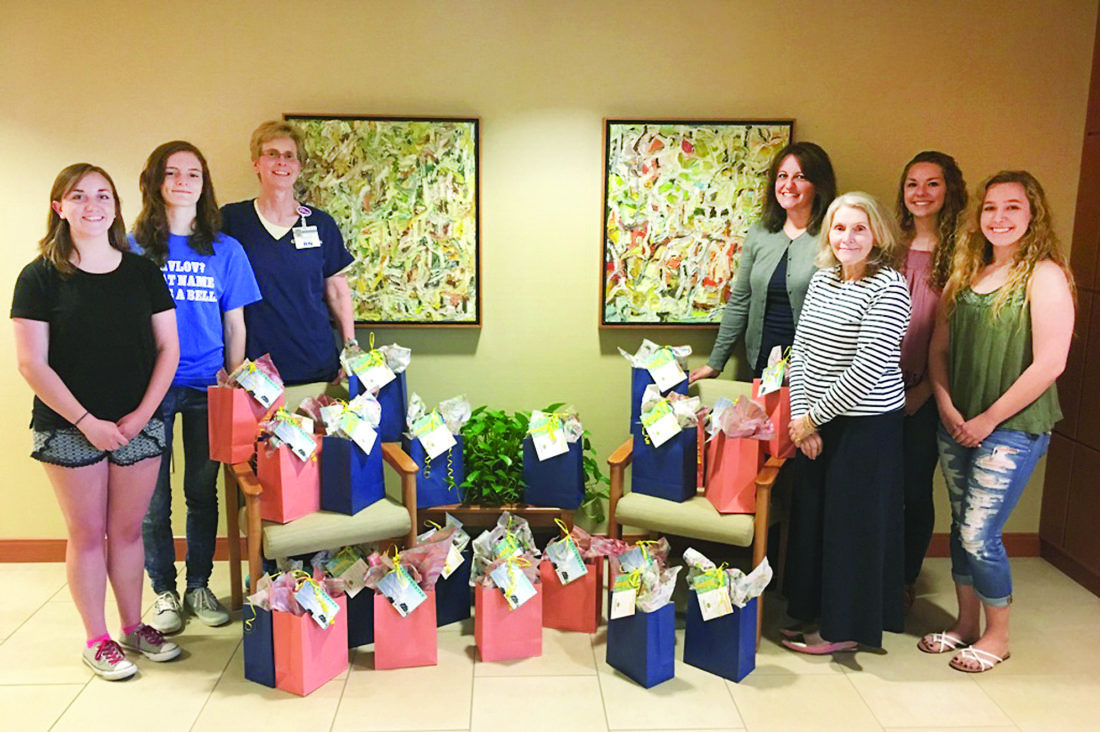 PHOTO PROVIDED Senior student officers from Hughesville High School's National Honors Society stand with Hope bags.